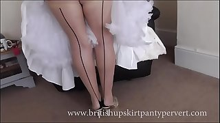 Upskirt and petticoats  64yr old British milf housewife in stockings shows her subjugation